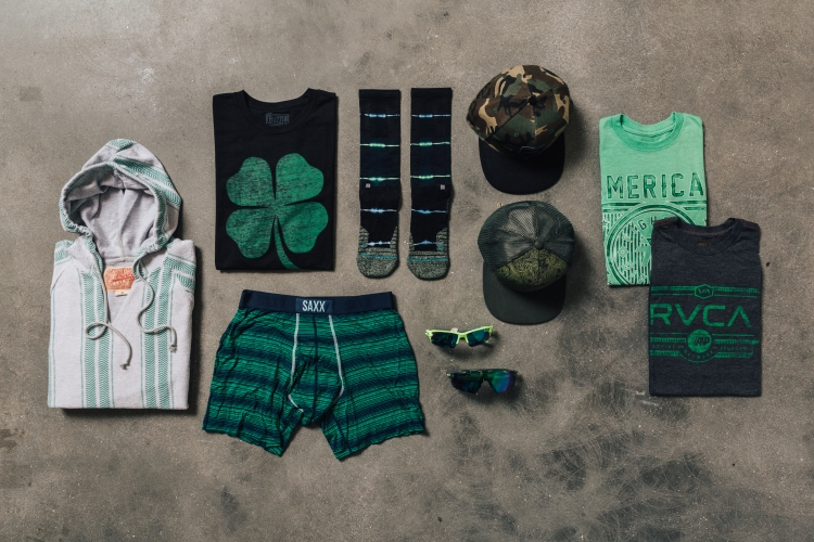 green-themed men's clothing lay down for St. Patrick's Day