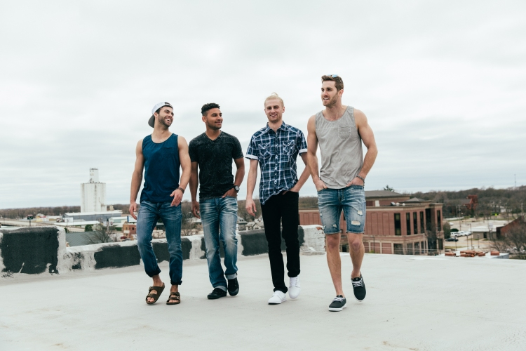 Guys on top of a building in Buckle clothes.