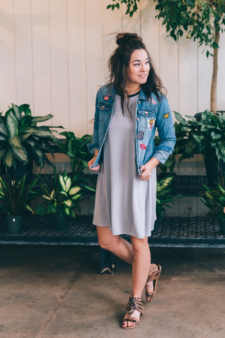 Girl in a patch denim jacket and dress.