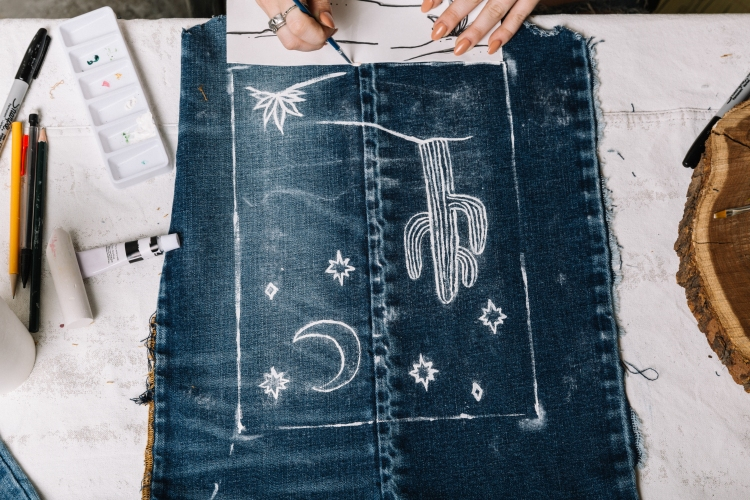 Desert painting on the denim tapestry.