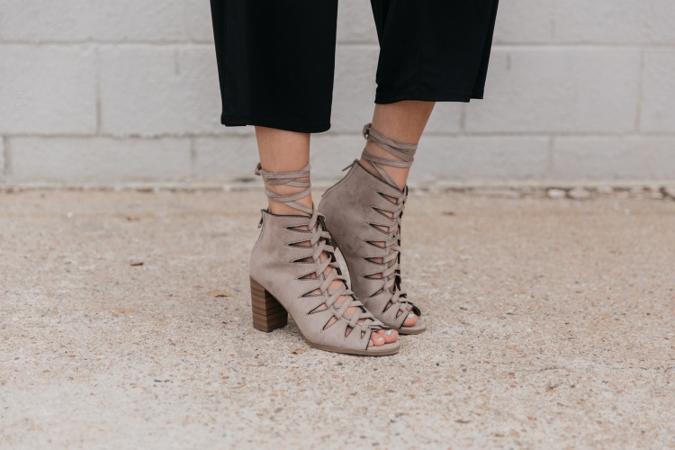 block trend heel with lace-up detailing.
