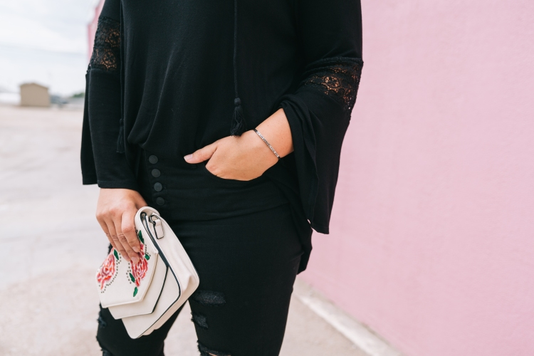 Black on black outfits call for a fun clutch - like this floral embroidered goodness from Violet Ray
