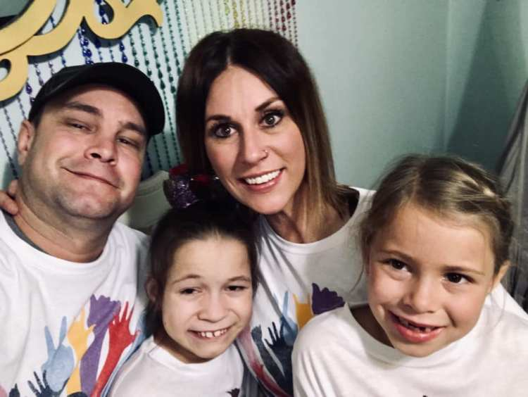 The whole DeGroot Family in their DisABILITY T-shirts inspired by their daughter Skyler.