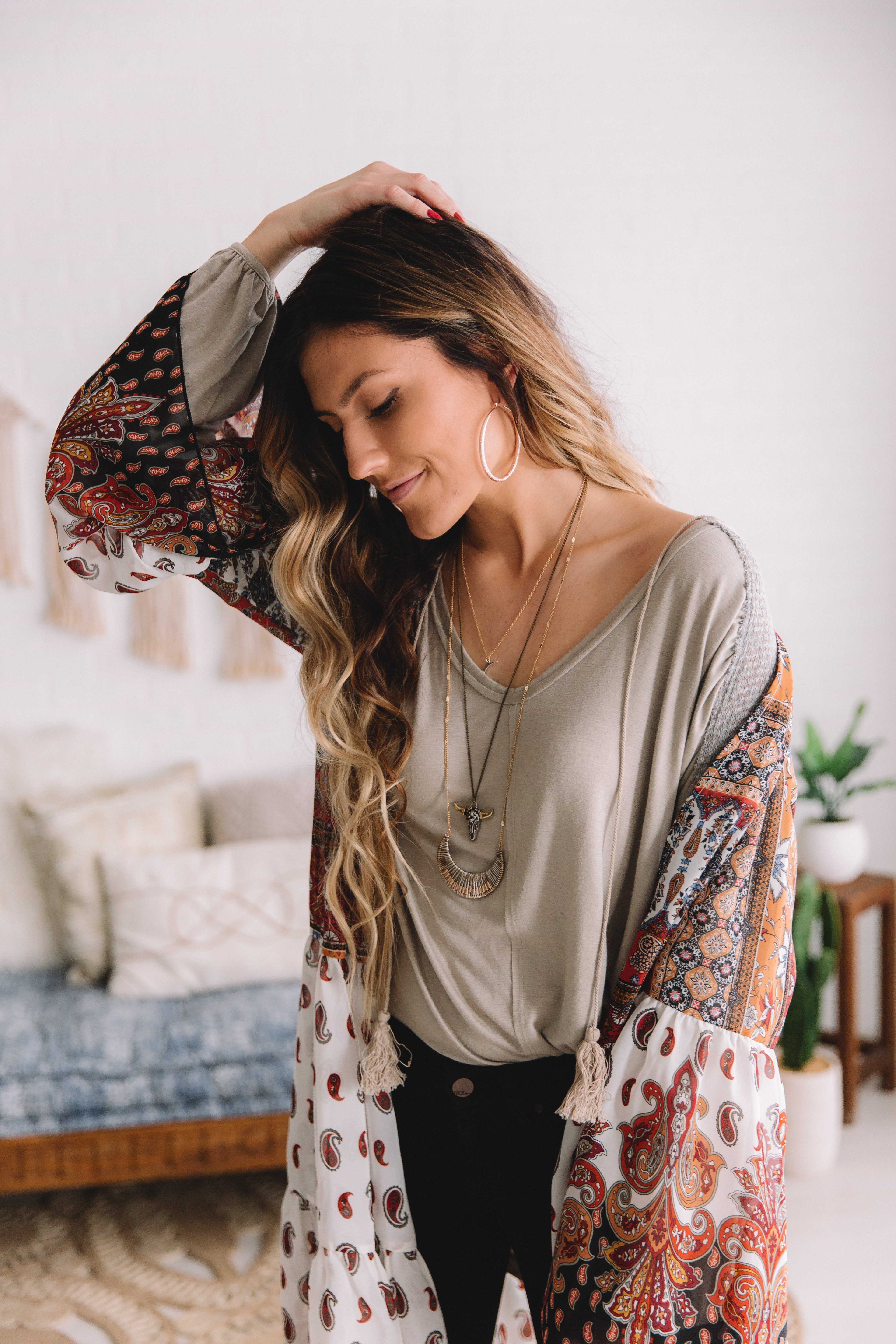 Western Inspired Outfits From Buckle featuring a Gimmicks Paisley Kimono, bull skull and crescent moon pendent necklaces.