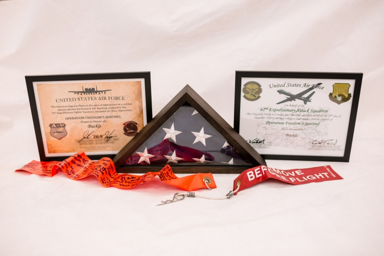 Buckle honored with certificates and flag flown in Afghanistan during a combat mission in support of Operation Freedom's Sentinel.