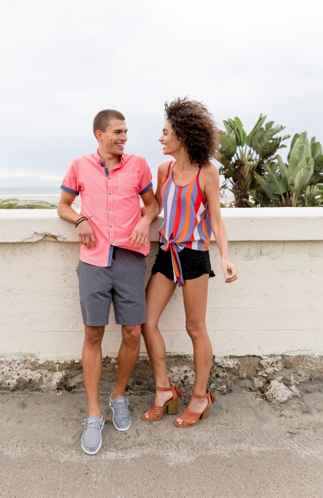 Men's and Women's Vacation Outfits from Buckle Featuring a Departwest button-up shirt, BKE shorts, Hey Dude Shoes, Buckle Black tank top, KanCan Signature distressed Black Jean shorts, and East Lion heels
