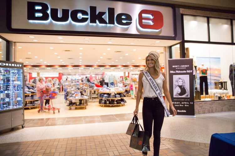 Miss Nebraska USA, Lex Najarian, in her crown and sash, walking about of a Buckle store after her personal styling session and fan meet and greet