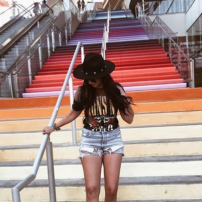 Women's outfit fearing a Guns N Roses Band Tee and Distressed Shorts