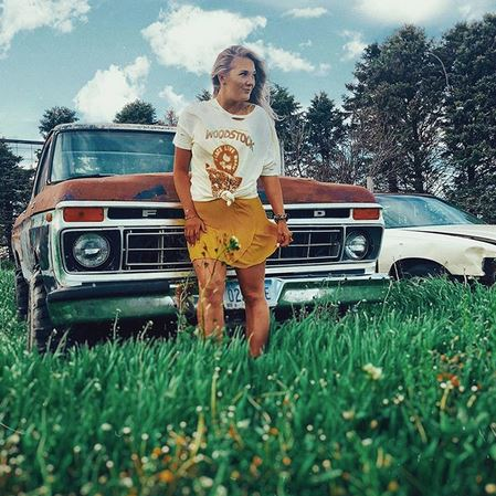 Ripped Woodstock Tee over yellow dress
