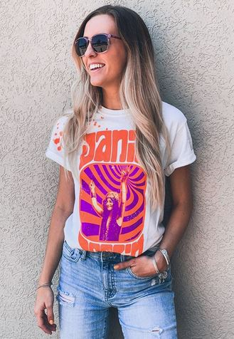 Women's outfit featuring a Goodie Two Sleeve Paint Splatter Janis Joplin Vintage Band T-shirt with distressed denim jeans and sunglasses.