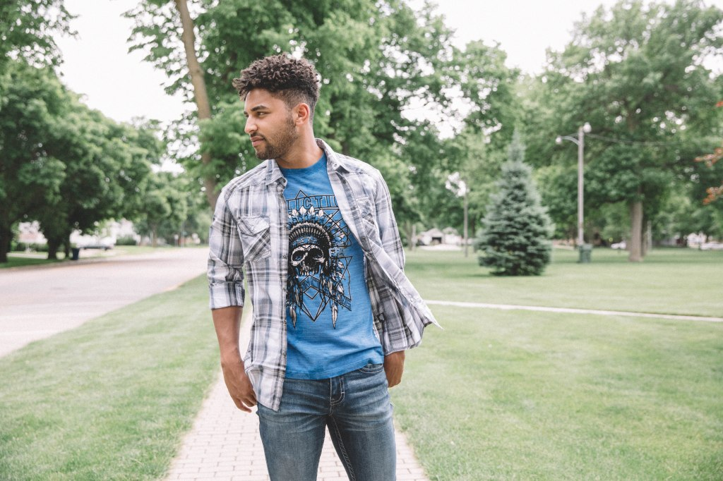 go for the classic approach by pairing graphic tees and plaid with a medium wash jean.