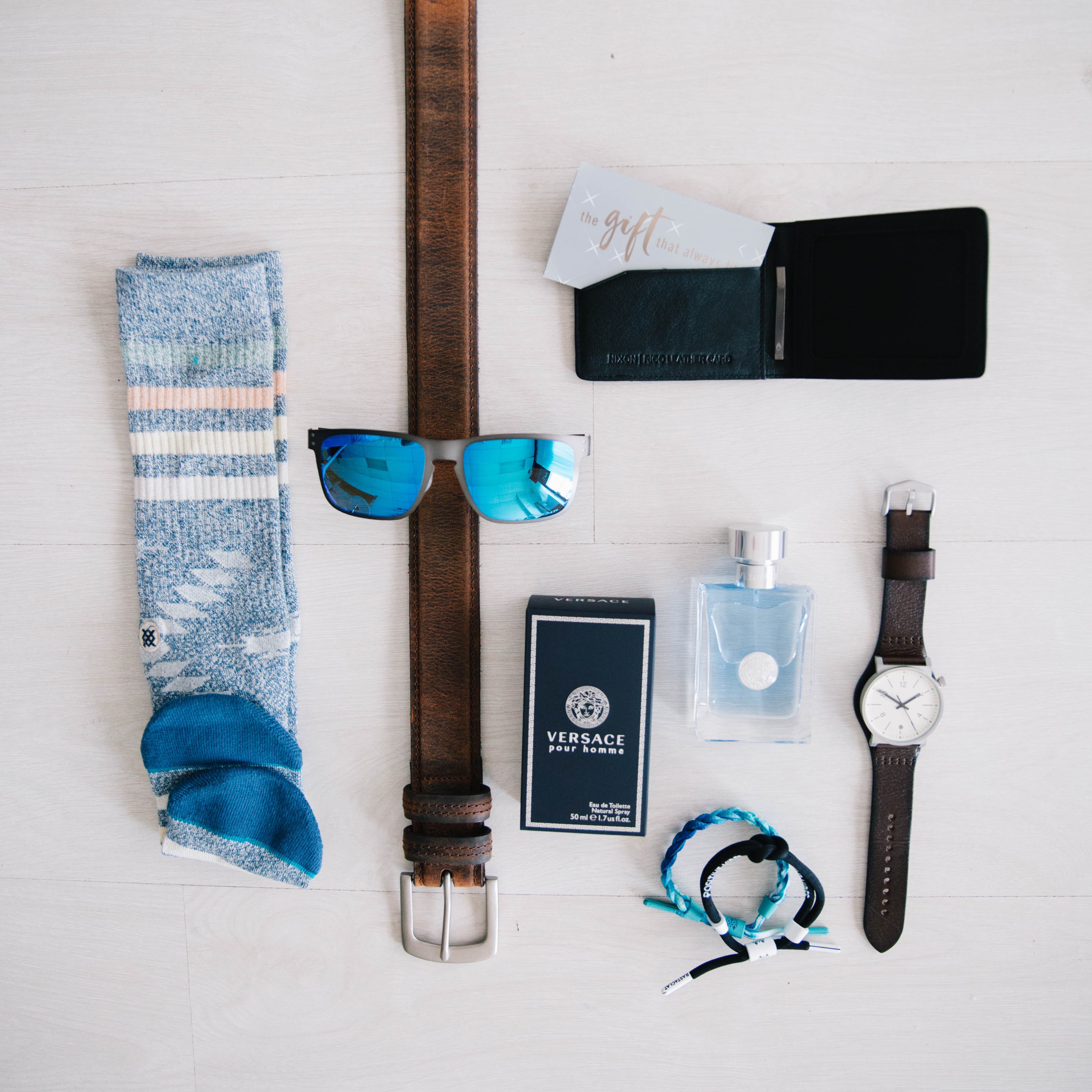Premium Accessories for Father's Day Gifts - genuine leather belts and wallets, statement-making watches, cologne and Stance socks