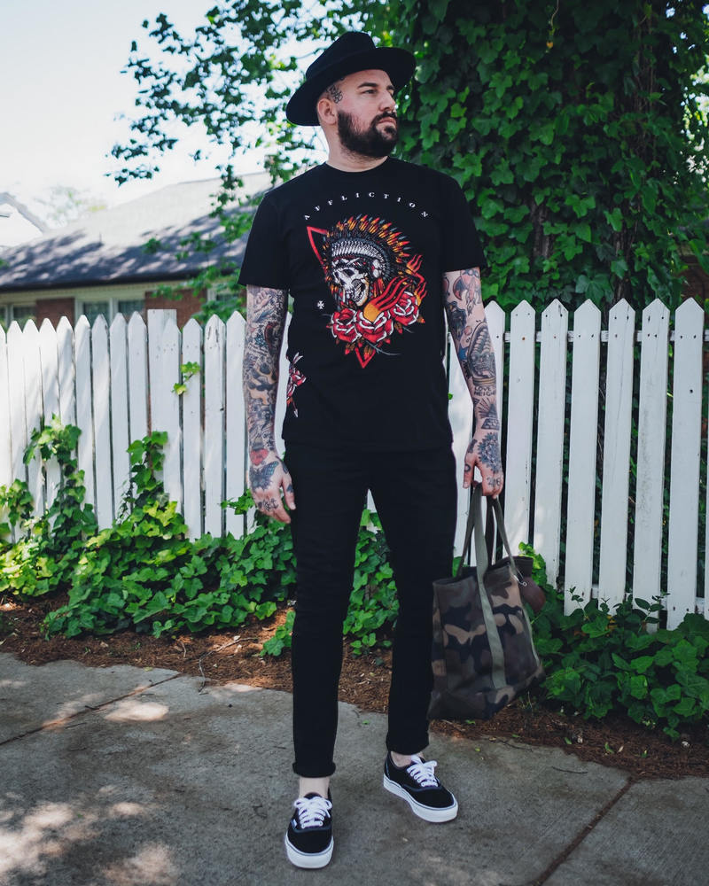 if you're looking to add a little off-duty cool to your rotation,, we suggest looking into Sullen and Affliction's graphics paired with a black denim.